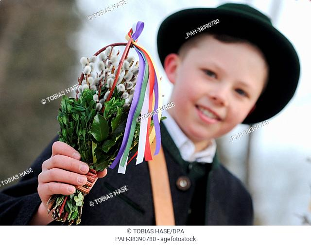 Twelve-year-old Hansi takes part in a Palm Sunday procession in Rottach-Egern, southern Germany, 24 March 2013. Palm processions, at the beginning of Holy Week