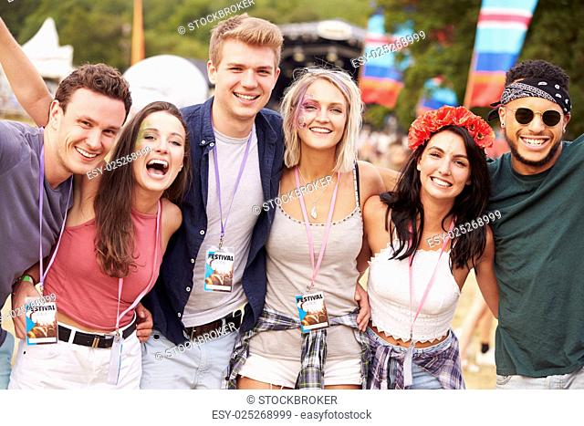 Group of friends hanging out together at a music festival