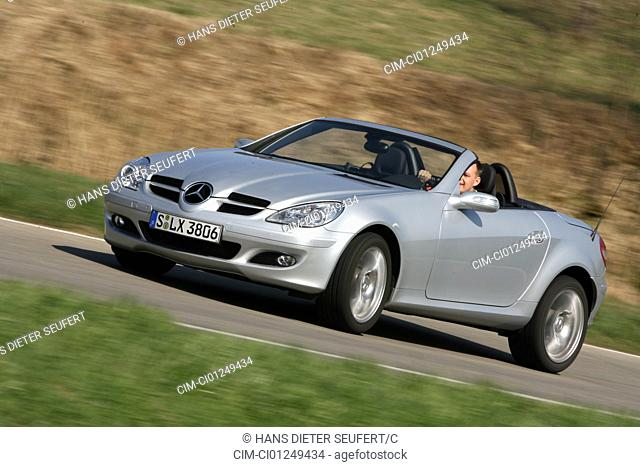 Mercedes SLK 350, model year 2004-, silver, driving, diagonal from the front, frontal view, country road, open top