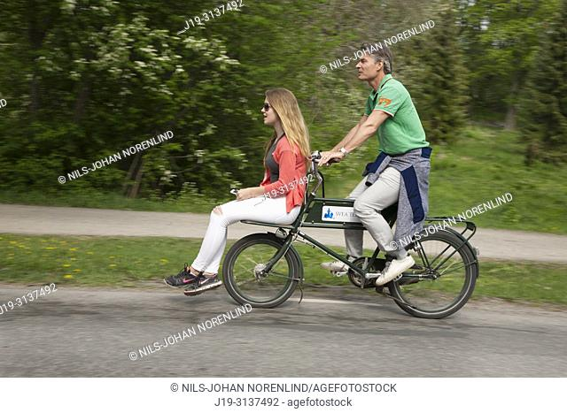 Couple on bicycle in Stockholm, Sweden