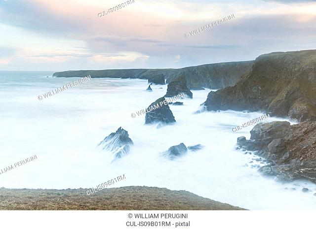 Frothy ocean waves crashing on cliffs, Trenance, Cornwall, UK