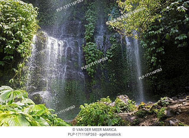 Benang Kelambu Waterfall in tropical forest near the village Aik Berik, North Batukliang, Central Lombok, Indonesia