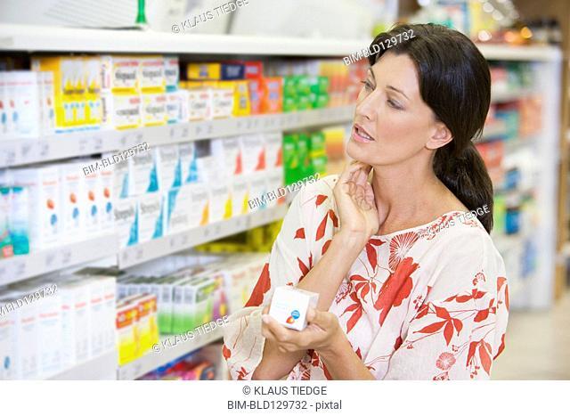 Caucasian woman shopping in drugstore