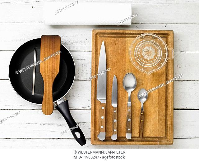 Kitchen utensils for making apple kebabs with almond caramel