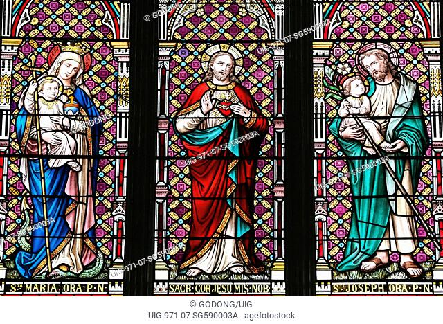 St Joseph's church. Stained glass window. Jesus and Holy Virgin