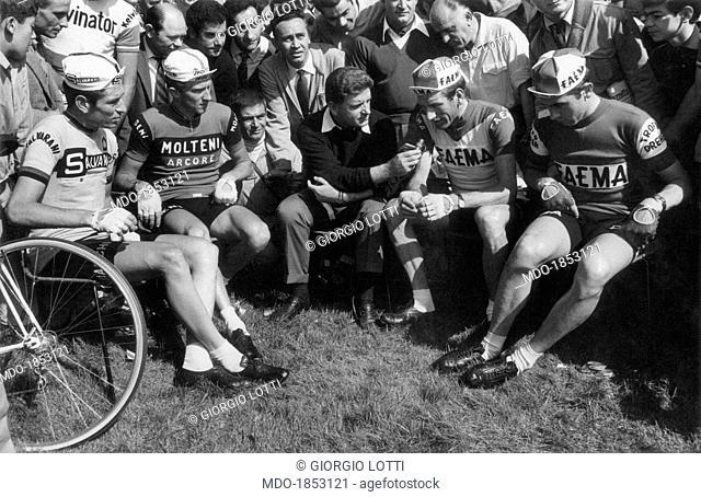 Italian journalist Sergio Zavoli interviewing Italian cyclist from Salvarani team Felice Gimondi, Italian cyclist from Molteni team Gianni Motta