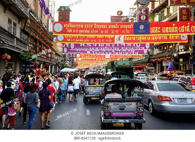 Heavy traffic in Yaowaraj road, tuk tuks and banners announcing the Chinese New Year festival, Chinatown, District Samphanthawong, Bangkok, Thailand