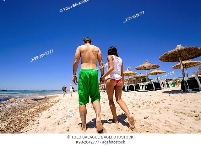 couple walking on the beach, beach Es Trenc. Mallorca. Balearic Islands. Spain