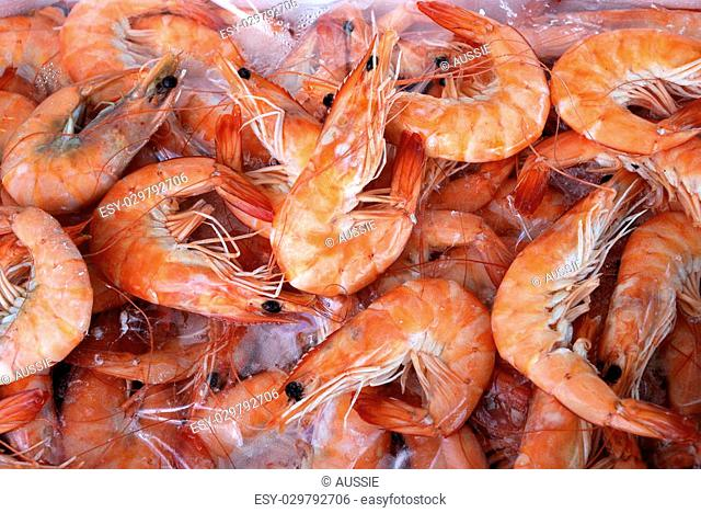 Background of fresh cooked prawns for sale at a market