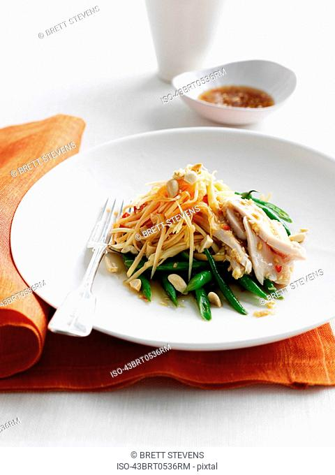 Plate of chicken with noodles and beans
