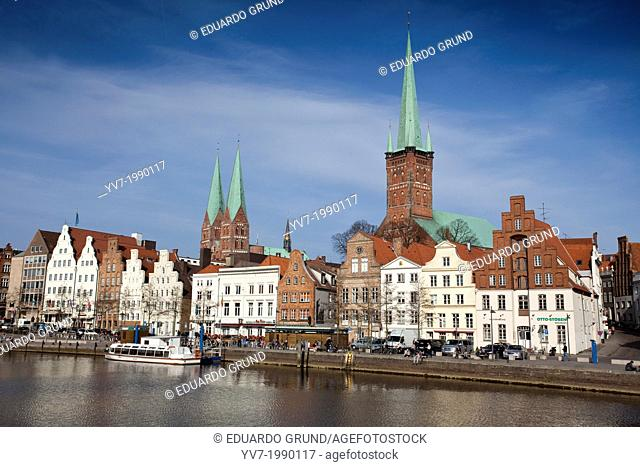 View of Lubeck, from the other side of one of the canals that surround the city, highlighting the tower of the Church of Santa Maria, and the tower of St Petry