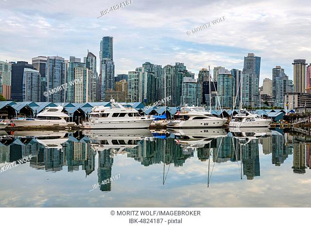 Skyscrapers and sailboats in the marina, skyline of Vancouver reflected in the sea, Coal Harbour, Downton Vancouver, British Columbia, Canada