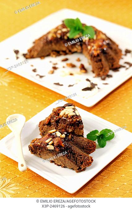Chocolate pudding with pine nuts