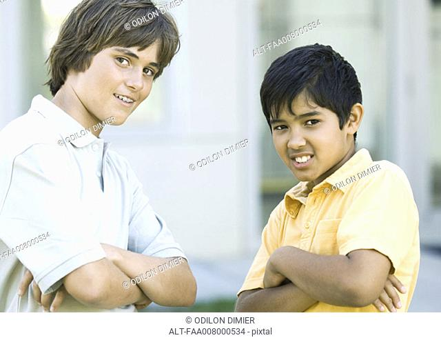 Preteen boys with arms crossed