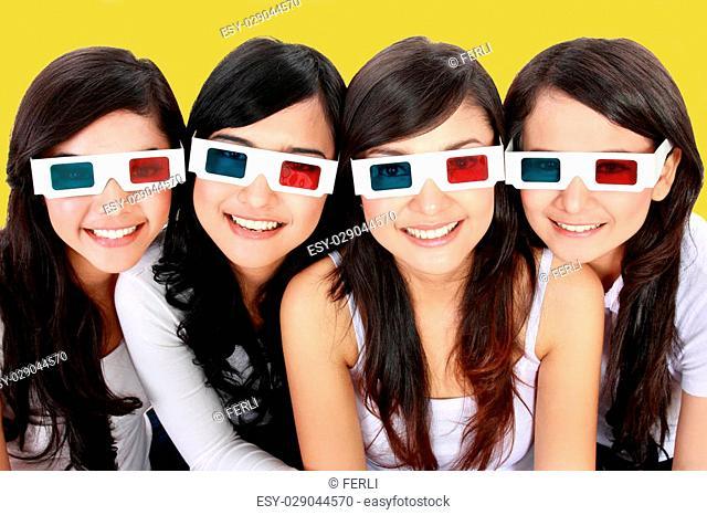 portrait of four woman wearing 3d glasses