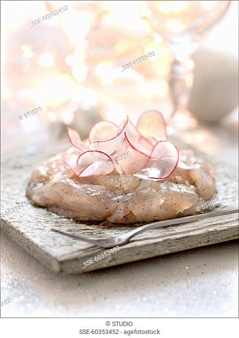 Sea bream carpaccio and thinly sliced radishes with vanilla oil