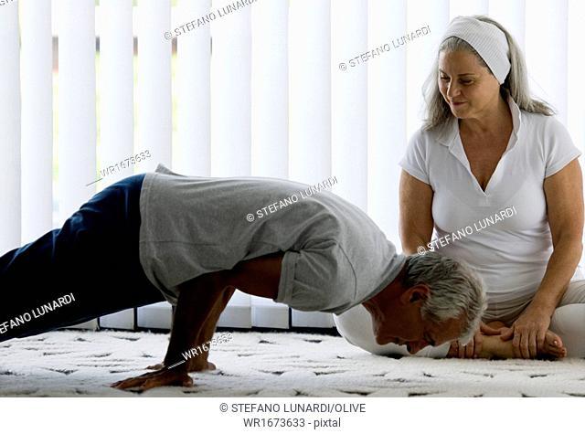 Mature couple doing yoga
