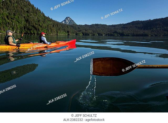 Couple Kayaking in Halibut Cove Lagoon near Kachemak Bay near Homer, Alaska, Summer