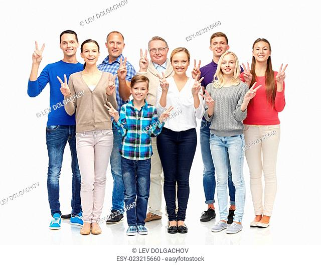 family, gender, victory and people concept - group of smiling men, women and boy showing peace hand sign