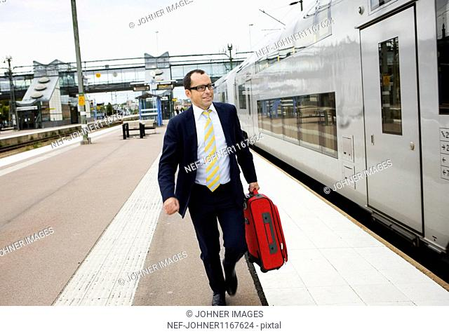 Businessman about to board high speed train