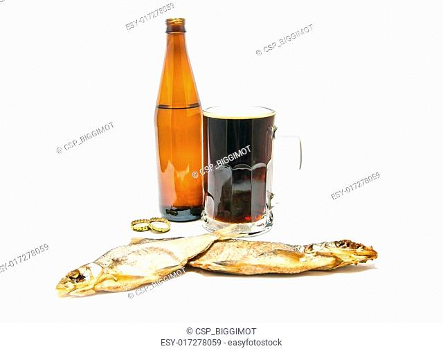 two salted fishes and dark beer closeup