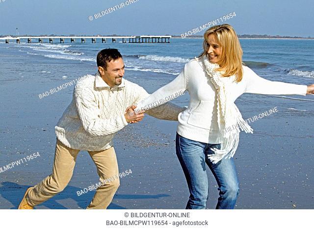 couple having fun by the sea