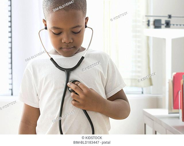 Mixed race boy listening to his heartbeat