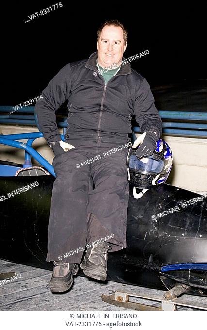 Wheelchair athlete sitting on bobsled;Calgary alberta canada