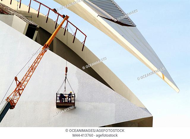 Men working in the City of Arts and Sciences, by S. Calatrava. Valencia. Spain