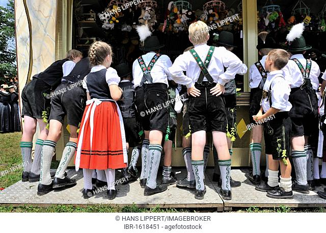Girl and boys at a shooting gallery, Loisachgau folklore festival, Neufahrn, Upper Bavaria, Bavaria, Germany, Europe