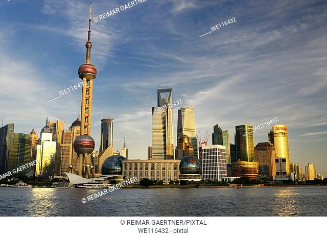 Sunset glow on high rise financial towers and hotels in the Pudong east side of Shanghai China