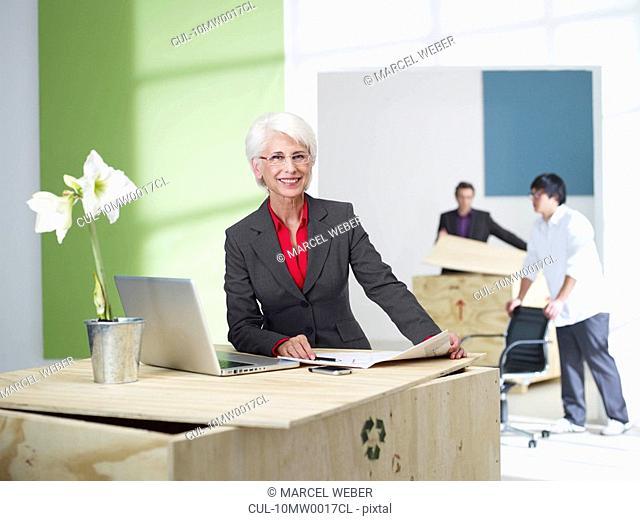 Female senior superior in new office