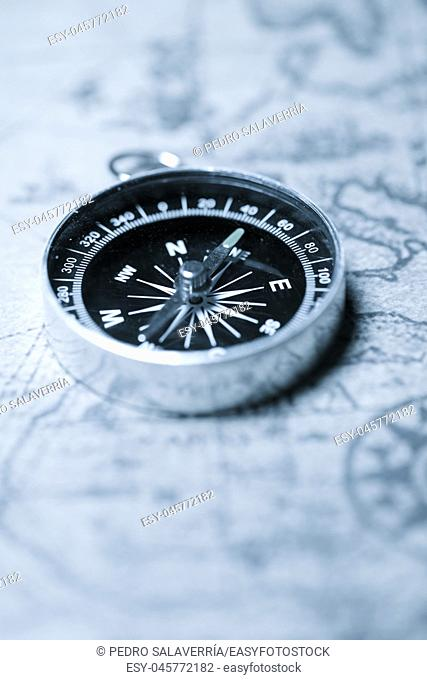 Vintage compass and old navigation map