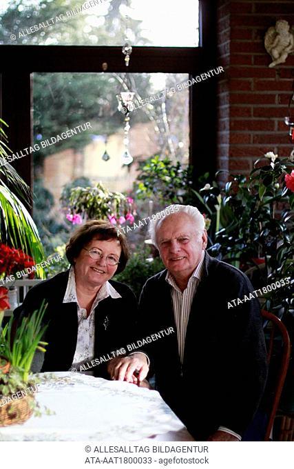 Elderly couple sitting in the garden