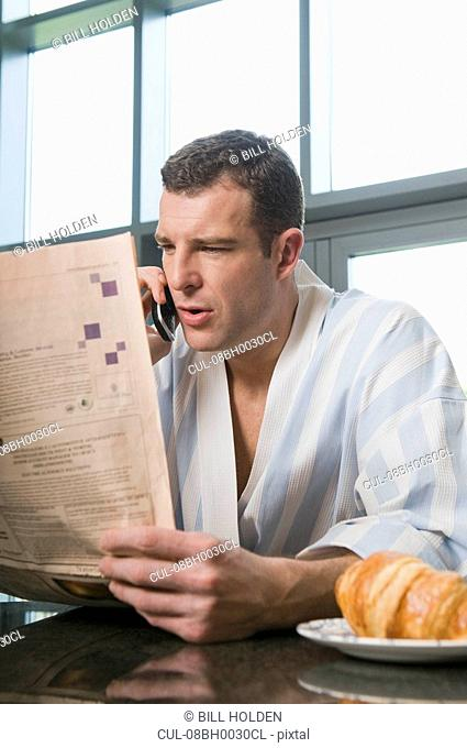 Portrait of a male reading the paper