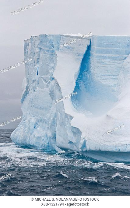 A huge tabular iceberg in the Drake Passage approaching the Antarctic Peninsula during the summer months  More icebergs are being created as global warming is...