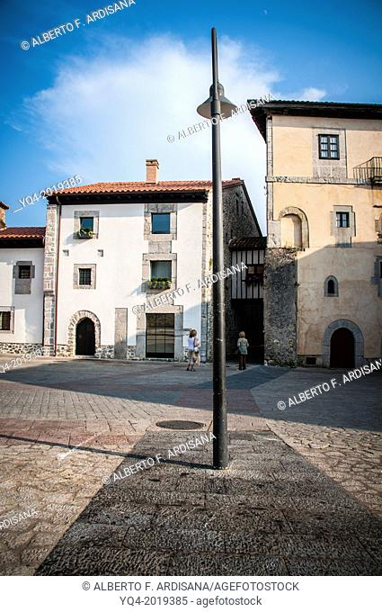 Image of Old Llanes. The areas where the wall missing, are marked with darker pavement.Asturias. Spain