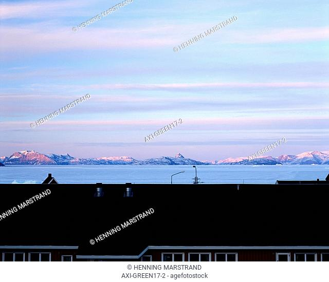 View over rooftop towards coastline and mountains