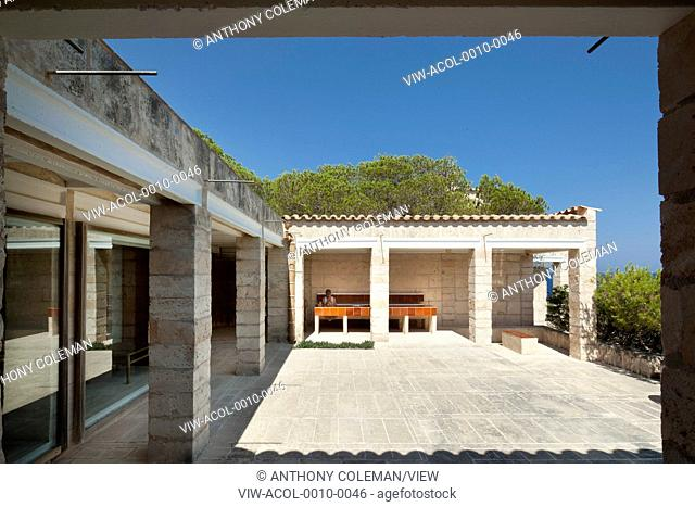 Can Lis, Mallorca, Spain. Architect: Utzon, Jorn, 1971. Main courtyard patio with built in stone tiled seats and table