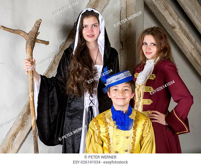 three kids dressed as prince,princess and witch