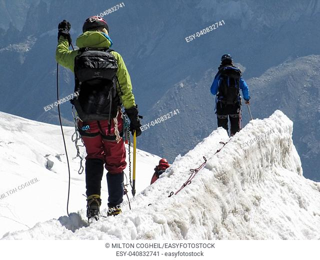 Trekkers on Aiguille Du Midi, in the french alps
