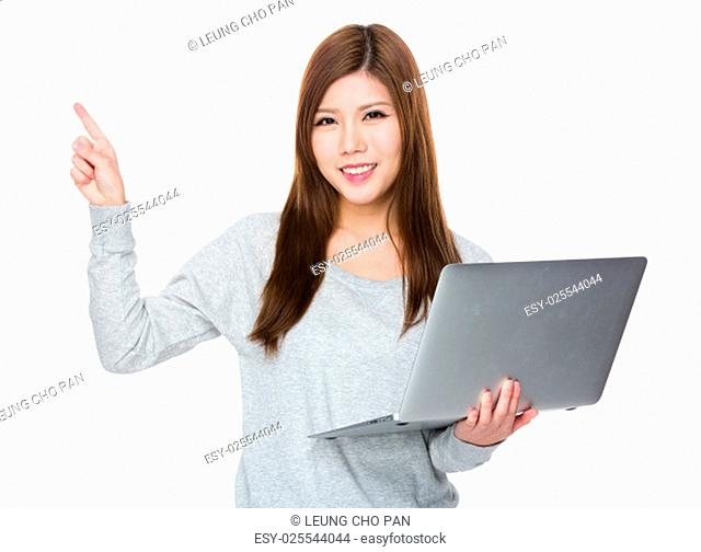 Asian woman use of laptop computer and finger point up