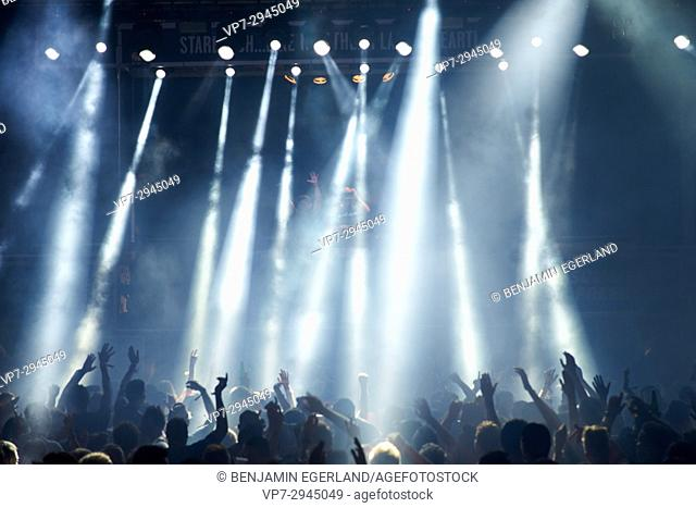 party people cheering at music festival Starbeach in Hersonissos, Crete, Greece, on 16. August 2017, to hardstyle DJ Wildstylez and MC Villain