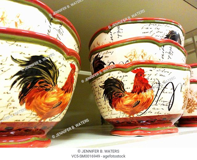 Rooster-themed dishes for sale at a retail store