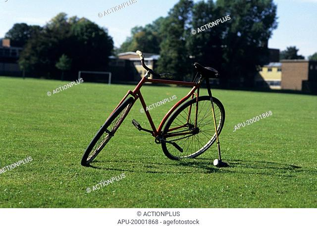 A polo bicycle with mallet and ball