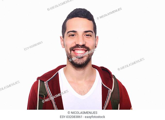 Close up of young latin man with backpack. Isolated white background
