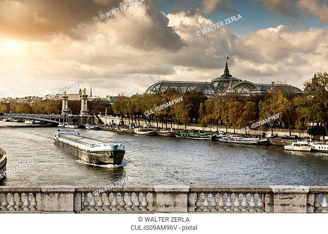 View of river Seine with the Grand Palace in distance, Paris, France