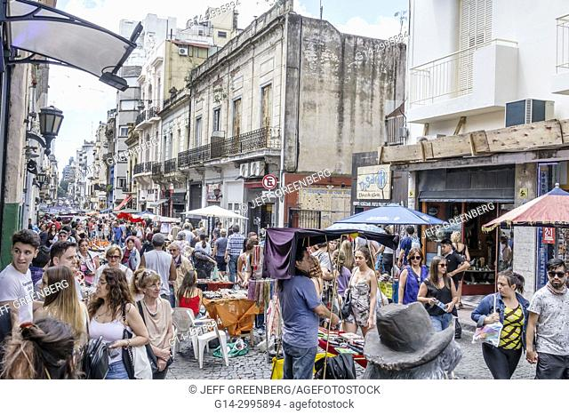 Argentina, Buenos Aires, San Telmo, art fair, marketplace vendors vendor booths stalls, shopping, antiques, man, woman, crowded, Hispanic