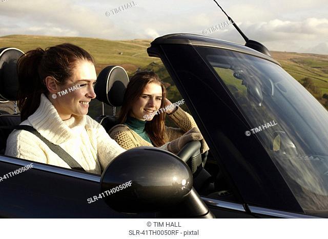 Women driving in rural landscape