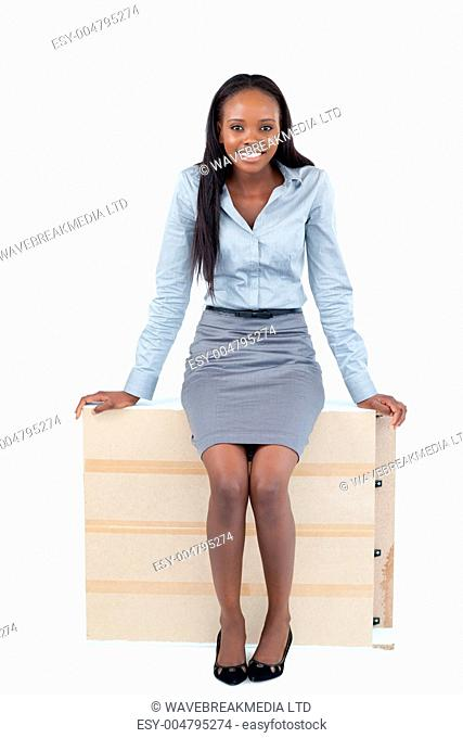 Portrait of a businesswoman sitting on a panel